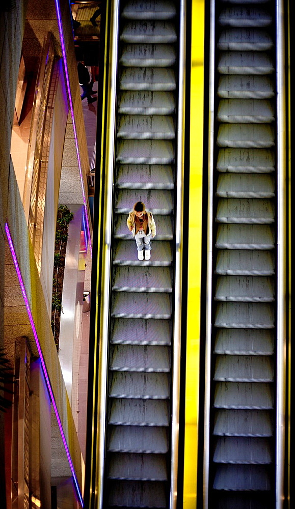 girl alone in mall
