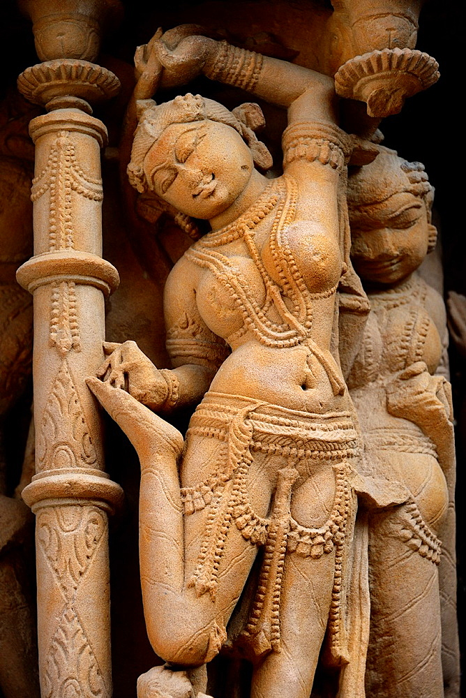 India, Rajasthan, Osian, Sachya Mata temple (12th C), Apsara removing a thorn from her foot.