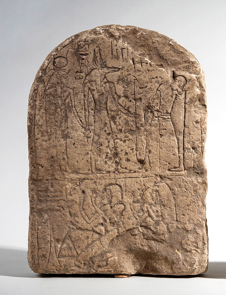 An Egyptian Limestone Stele 1st millennium BCE depicting Isis, Anubis and Ptah.