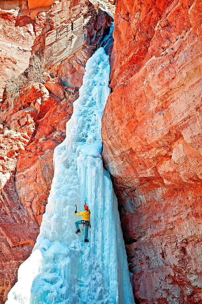 Ice climbing Cornet Falls which is rated WI-4 and located in the San Jaun Mountains near the city of Telluride in southwestern Colorado. - 817-440513