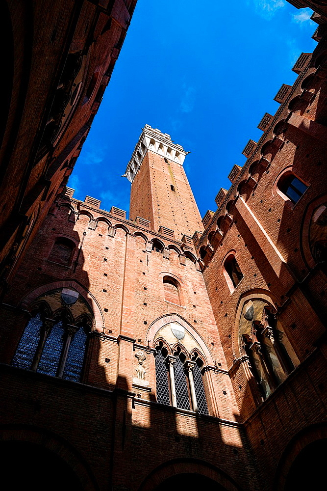 View of Torre del Mangia from the court of Palazzo Publico in Siena, Italy.