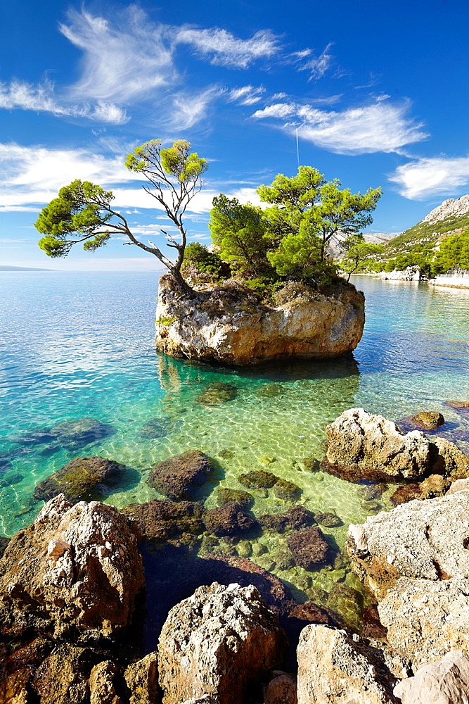 "Croatia, Makarska Riviera, ""Kamen Brela"" (Brela Stone) on the beach is the symbol of Brela Village, Dalmatia, Croatia."