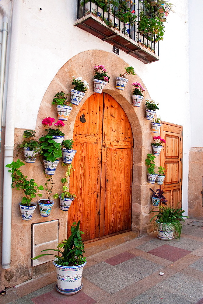door of a house decorated with flowers, Javea, Alicante, Spain.