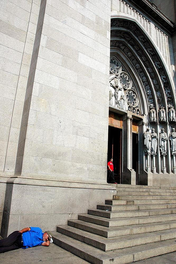 Sao Paulo, Brazil, homeless man sleeping at the entrance of the Catedral da Se