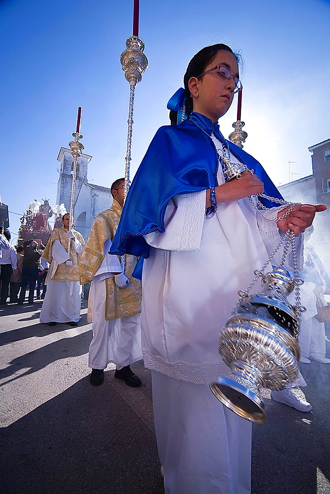Young people in procession with incense burners in Holy week, Spain.