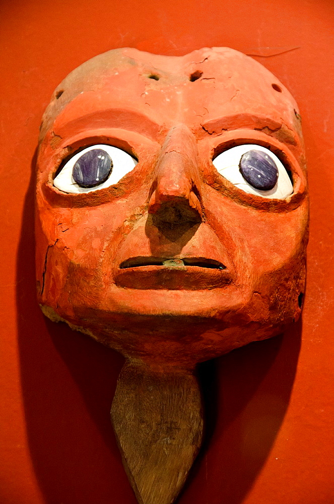 Wari wooden mask 500 AD-900 AD.Huaca Pucllana. Lima culture 200 AD and 700 AD. Miraflores district. Lima city. Peru.Archaeological site.