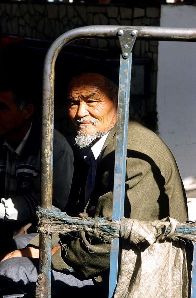 Bishkek, a old man is watching the market , Kyrgyzstan.