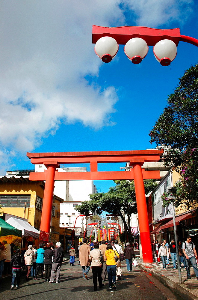 Sao Paulo, Brazil, Torii arch at the entrance of the Asian neighborhood of Liberdade, during the Japanese festival of Tanabata Matsuri
