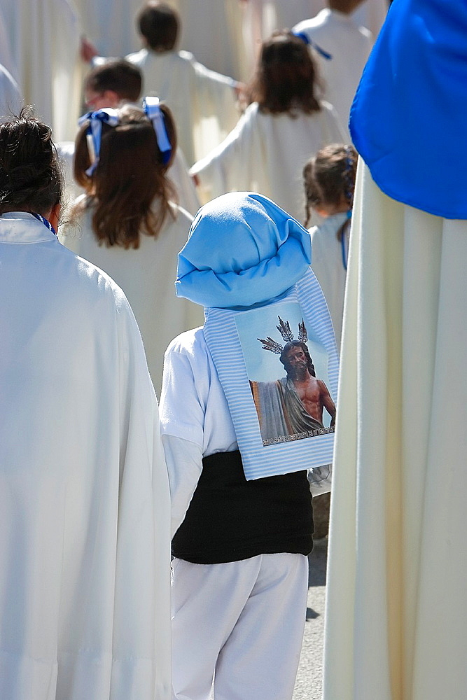 Boy dressed in costalero during a procession of holy week, Andalucia, Spain.