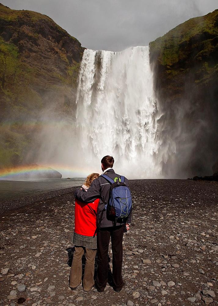 Couple at Skogarfoss Waterfalls, Iceland.