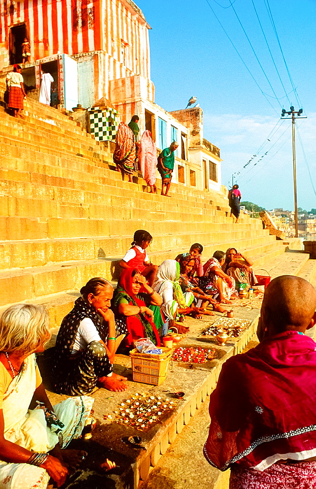 women having rituals at the ghats in Varanasi, India