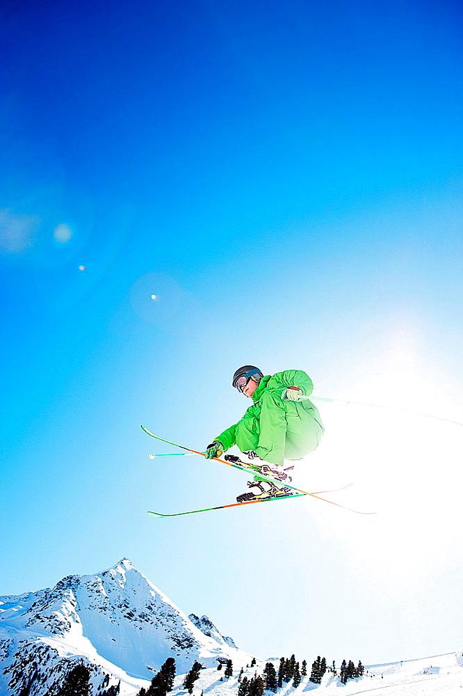 Skier jumping in midair