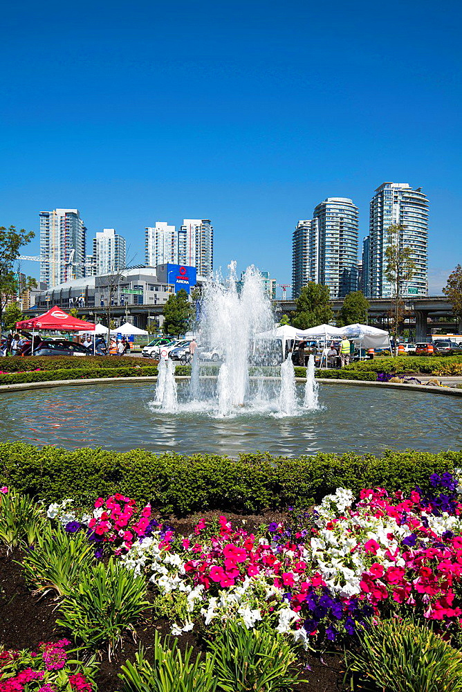 flowers and fountain at north west False Creek, Vancouver, BC, Canada.