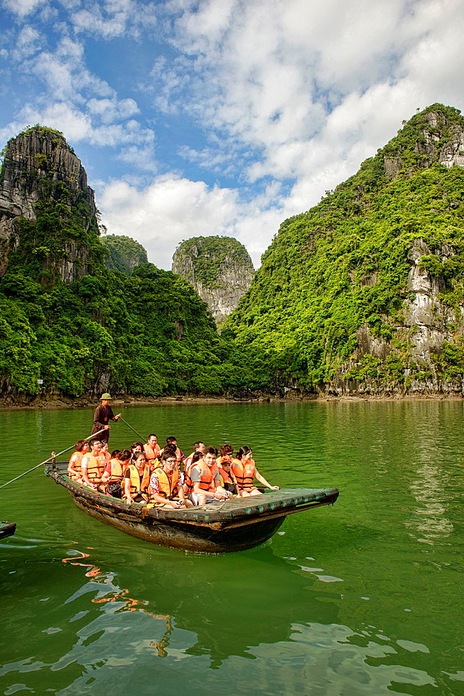 exploring a hidden lagoon by raft in Halong Bay, Vietnam.