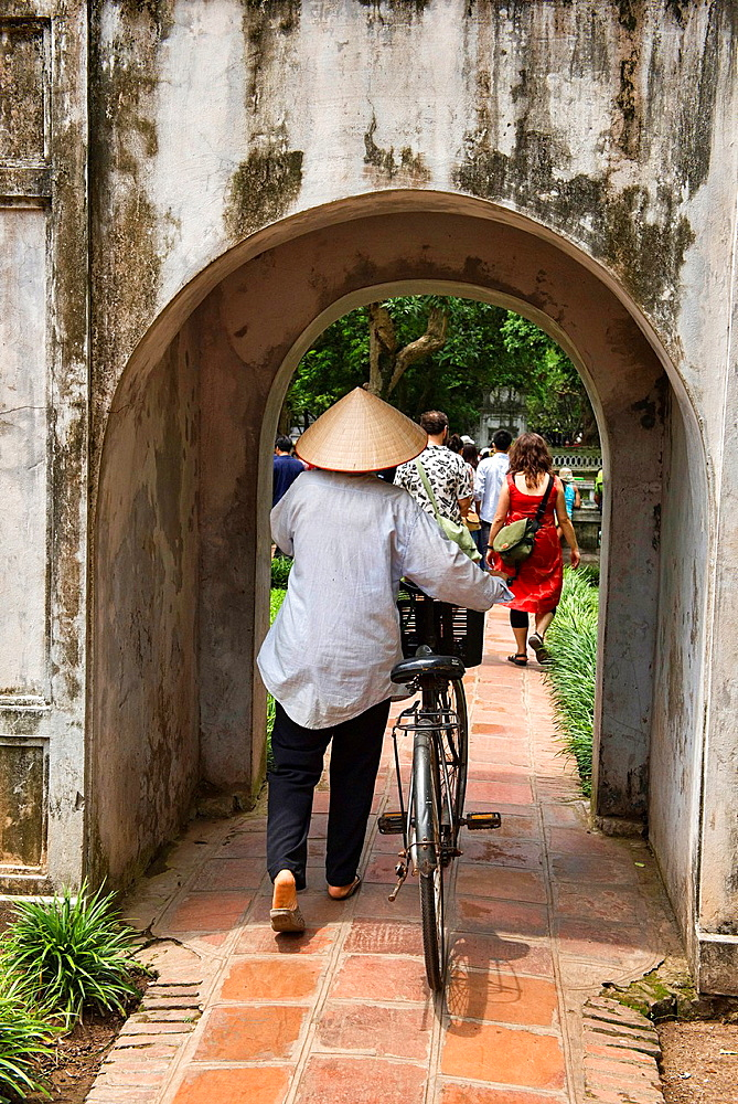 vendor and her bicycle at the Temple of Literature in Hanoi, Vietnam.