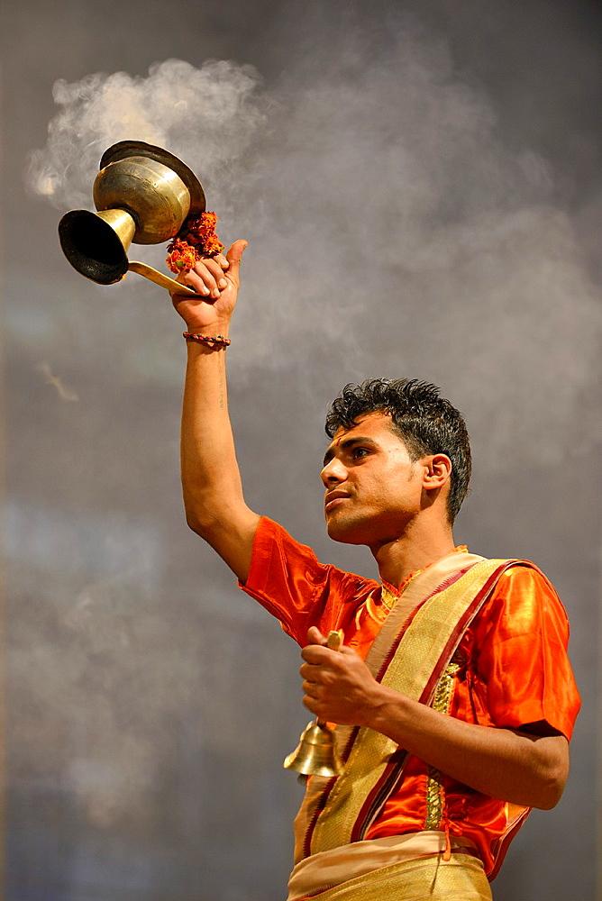 India, Uttar Pradesh, Varanasi, Aarti, Offering of incense to the Ganges.