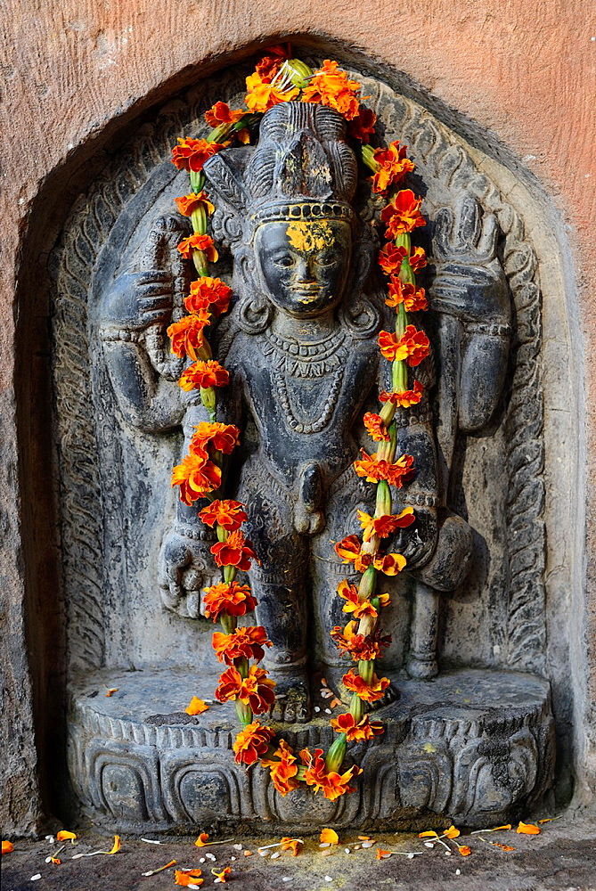 India, Uttar Pradesh, Varanasi, Lalita Ghat, Nepali temple (also called Kathwala temple), Garlanded bas relief of Kal Bhairava.