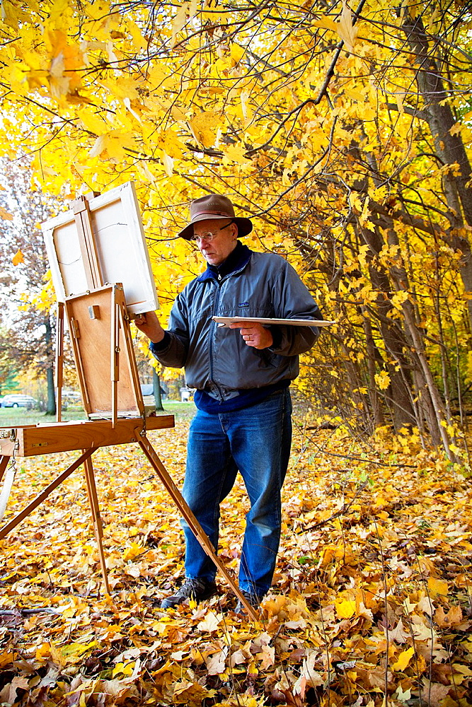 Porter, Indiana, An artist paints fall colors at Indiana Dunes National Lakeshore.