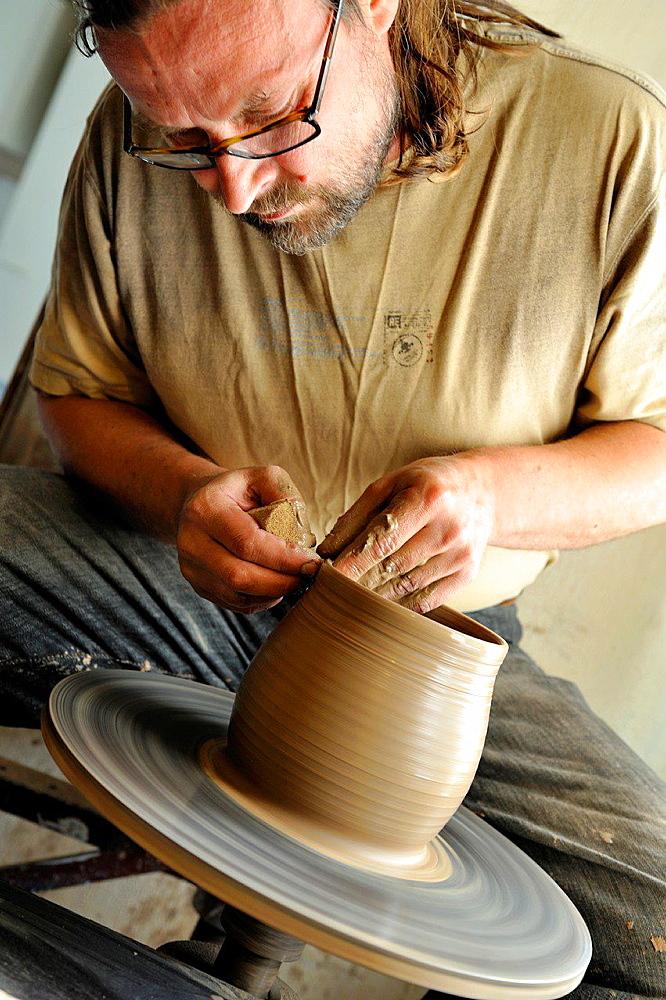 Ivars, potter craftman in his workshop at Kemeri, Jurmala, Gulf of Riga, Latvia, Baltic region, Northern Europe.