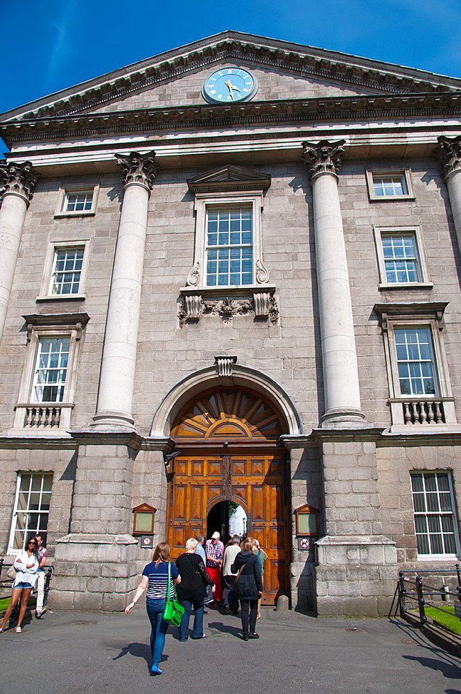 People going through West Front building to Trinity college university area central Dublin Ireland Europe.