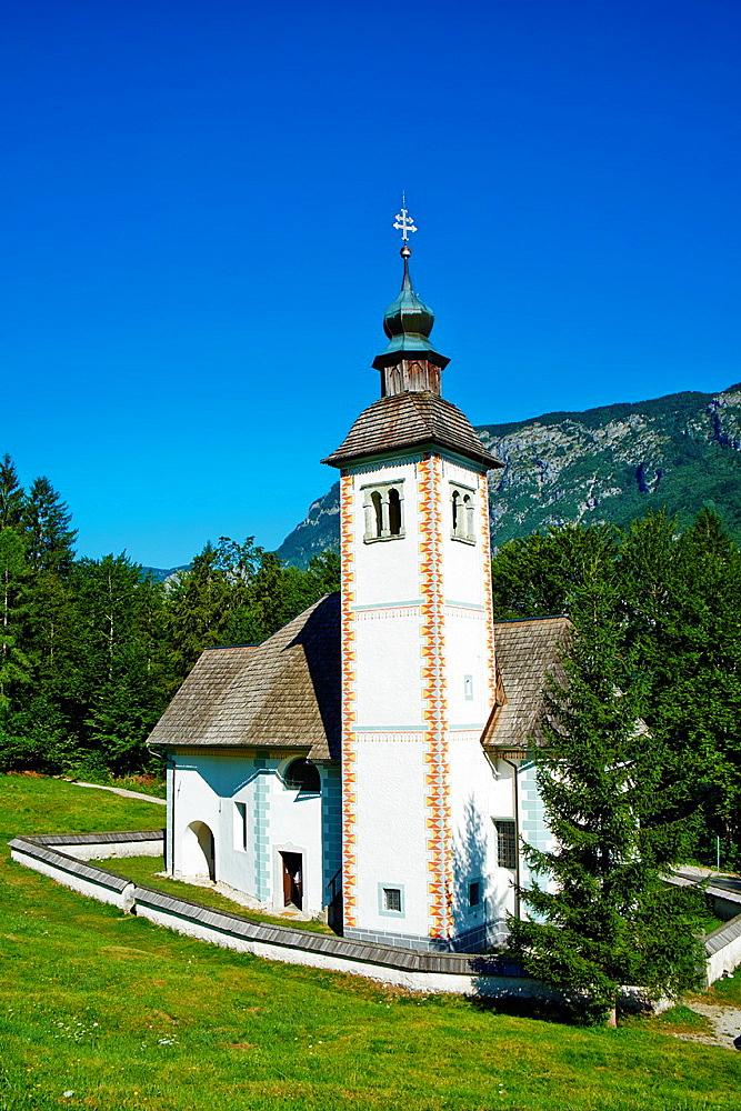 Slovenia, Gorenjska region, Triglav National Park, Bohinj lake and Sveti Duh church.