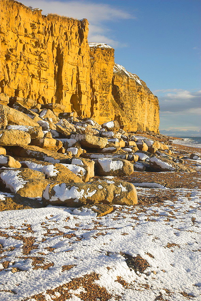 Rare occurance of Snow on the Beach at Burton Bradstock it rarely seen because the heat from the Sea which is warmer than the land melts it quickly Dorset.