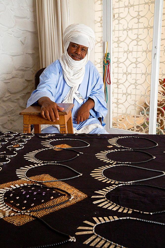 Silversmith Adam Zidia, a Tuareg from Agadez, Niger, offering Silver Jewelry at Biannual Arts Festival, Goree Island, Senegal.