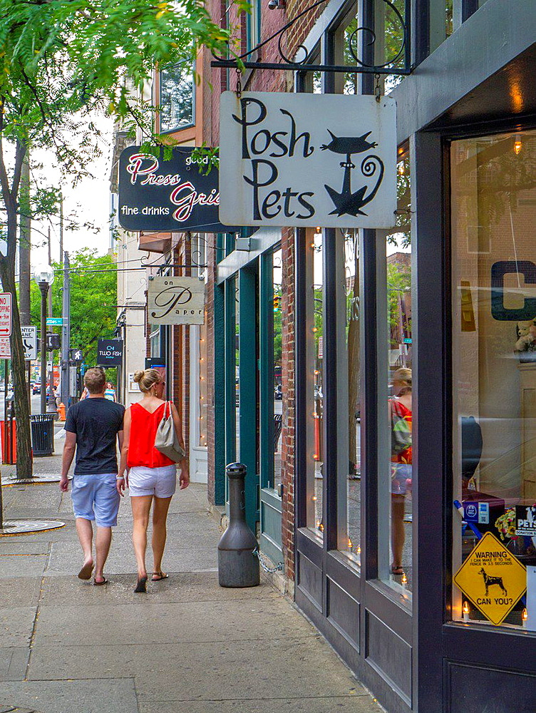 Couple walking in Short North area of Columbus Ohio United States.