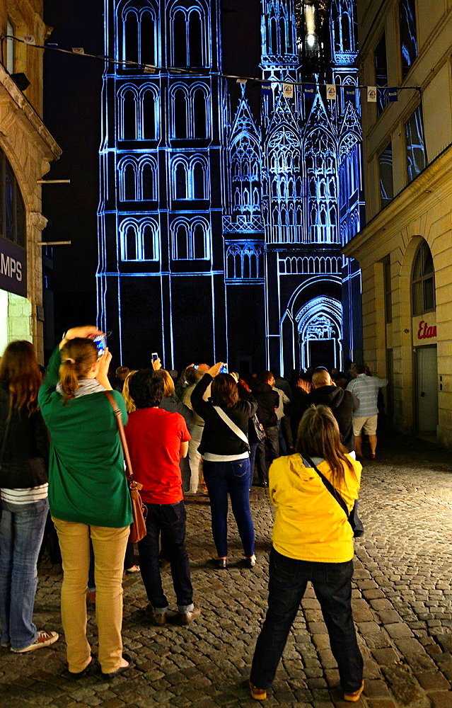 light show projected on Notre Dame cathedral in Rouen, presentation in memory of Jeanne d'Arc, Joan of Arc, Rouen is a place where she was burned at the stake for heresy at age 19, Rouen, Upper Normandy, France, Europe.