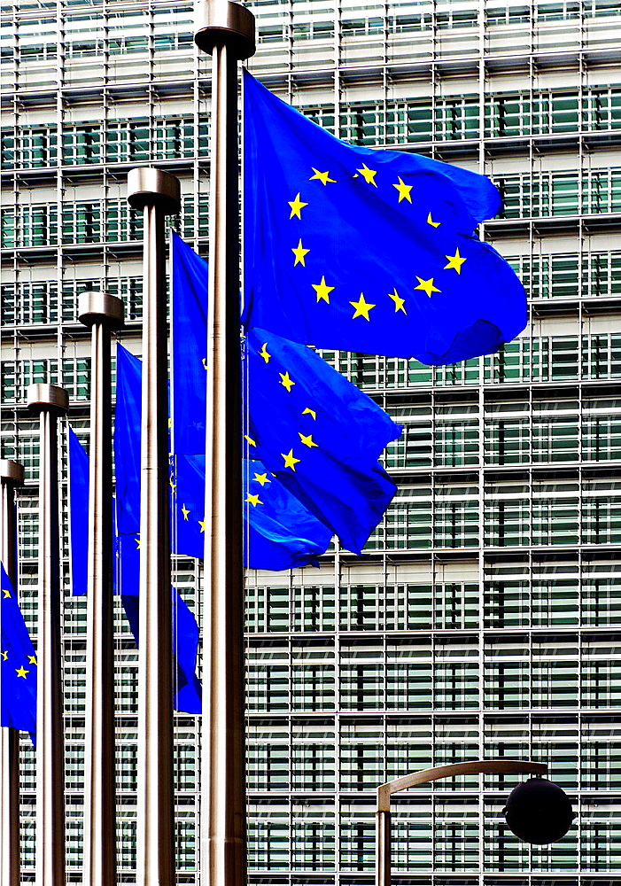 flags in front of European Commission building, flag of Europe was designed by Arsene Heitz and Paul M. G. Levy, Brussels, Belgium