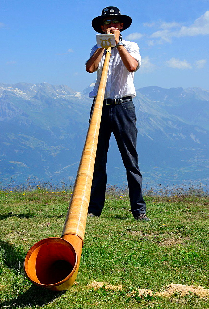 single man playing with alphorn, Nendaz, canton Valais, canton Wallis, Switzerland