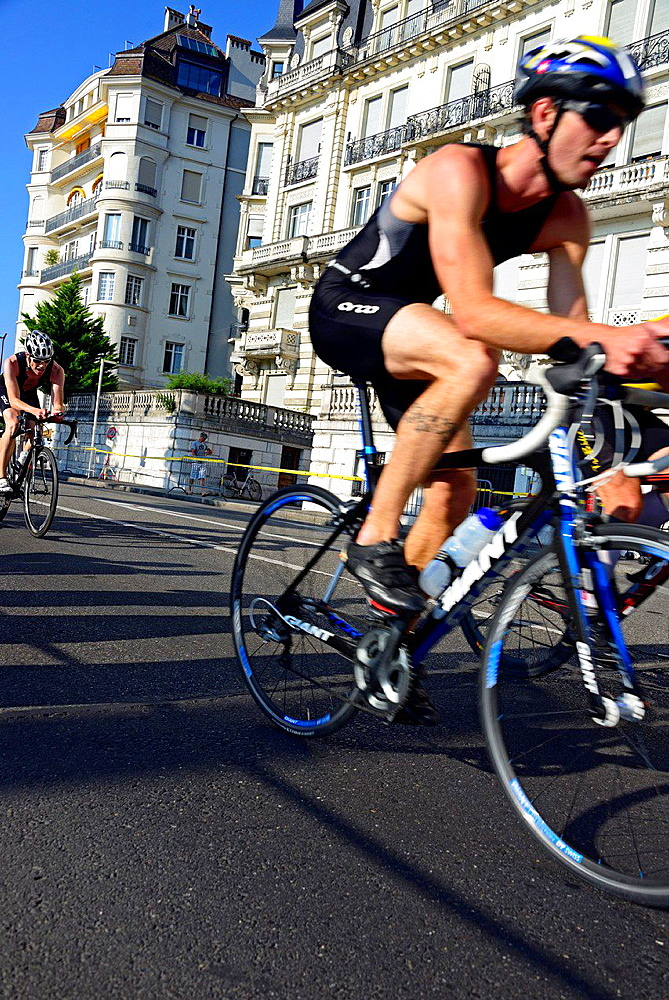 two athlets cycling, biking race, 25th International Geneva Triathlon, on July 21, 2013, Quai Wilson, Geneva, Switzerland.