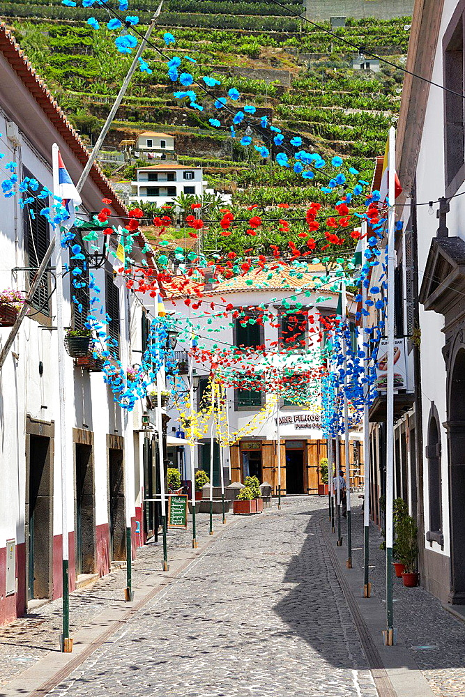 Street decorated with paper flowers on feast of Madeira, Camara de Lobos, Madeira, Portugal.
