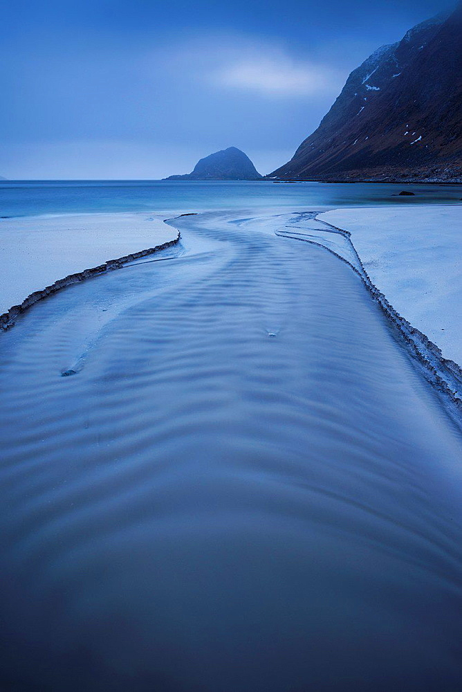 River flows through Haukland Beach, Vestvagoy, Lofoten Islands, Norway.