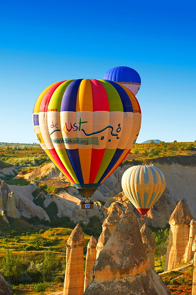 Hot Air Baloons over the Love Valley at sunrise, Cappadocia Turkey.