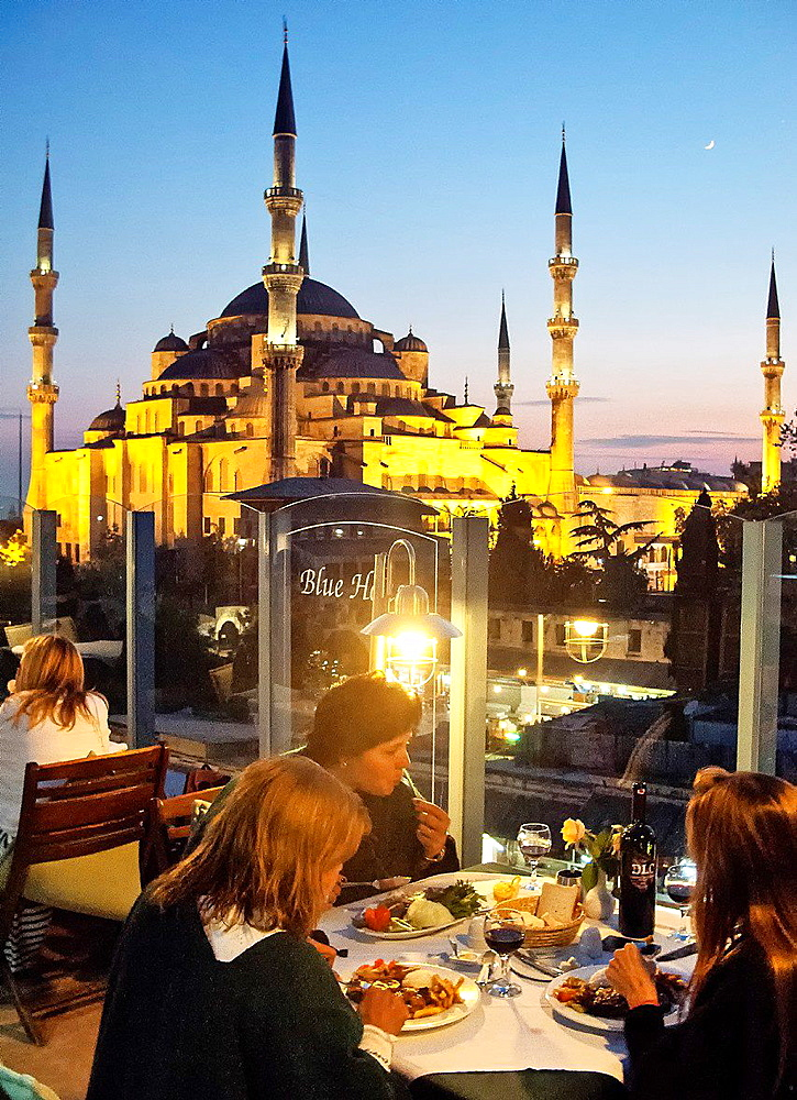 People dining at The Blue House Hotel Restaurant, Sultanahmet, Istanbul, Turkey.