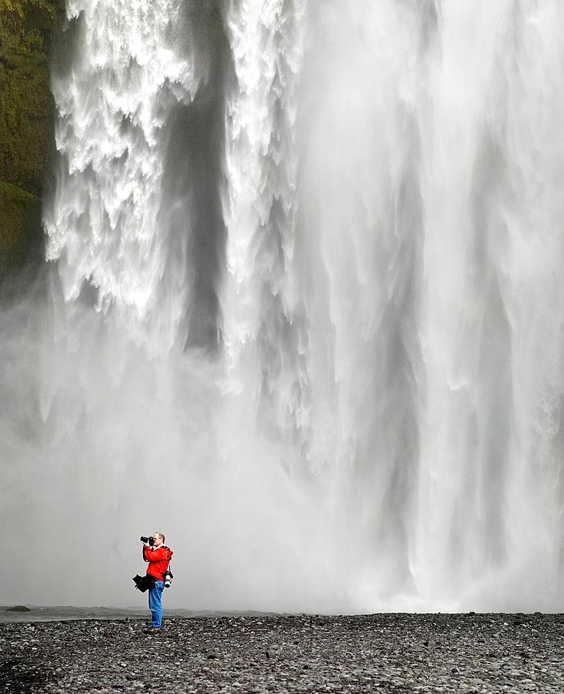 Photographing at Skogarfoss Waterfalls, Iceland.