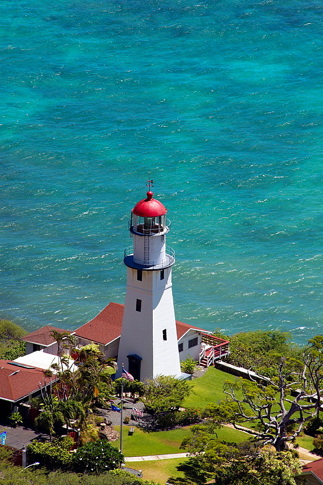 Lighthouse on the ocean shore near Honolulu, Hawaii.