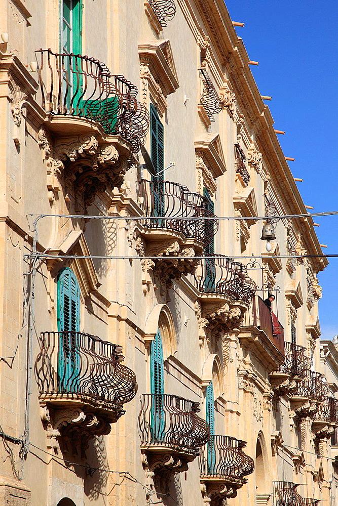 Italy, Sicily, Noto, palace, balconies.