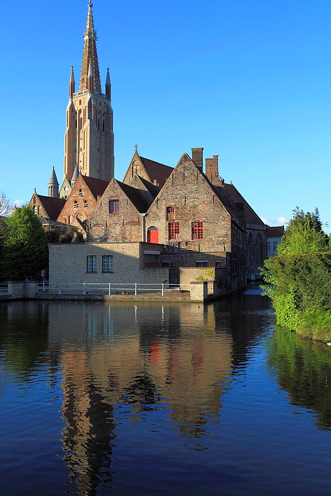 Belgium, Bruges, Church of Our Lady, canal scene.