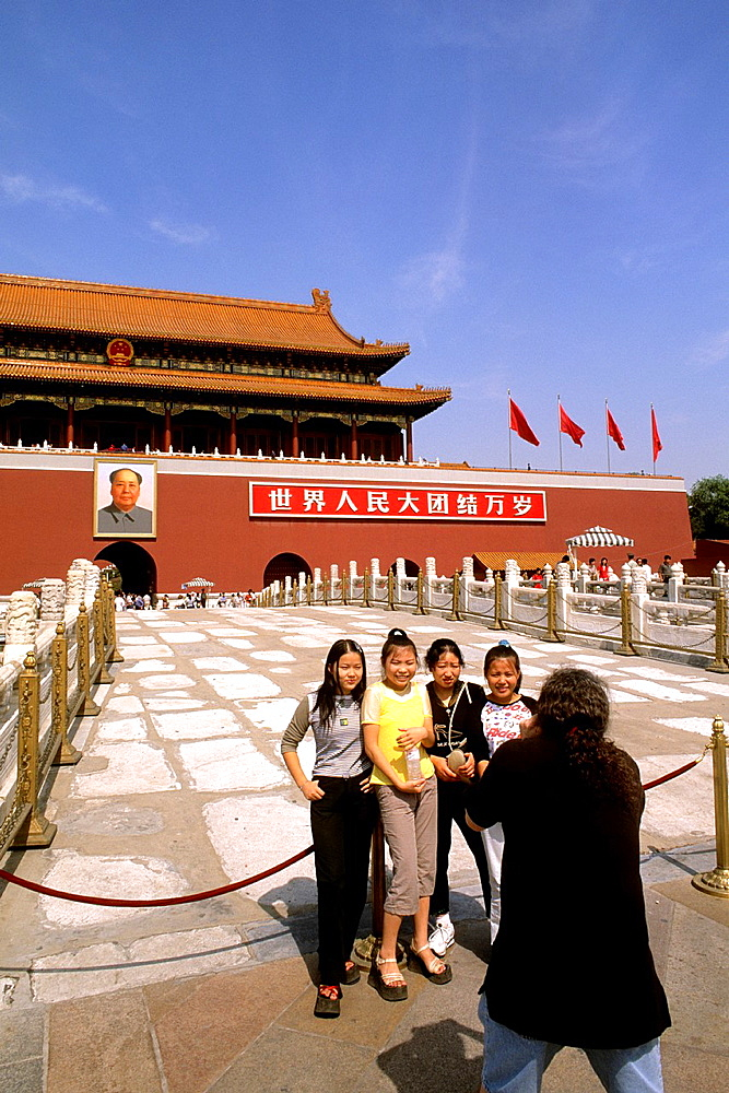 Tourist taking picture of Chinese children at the Forbidden City in Beijing China.