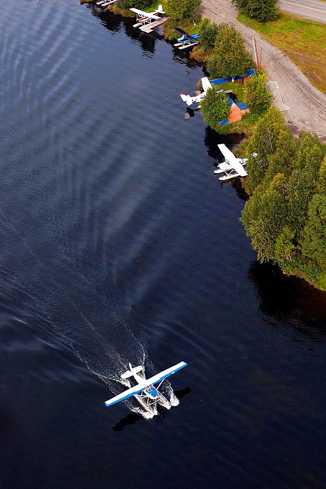 Aerial view of a floatplane landing on Lake Hood, Anchorage, Alaska, United States of America.
