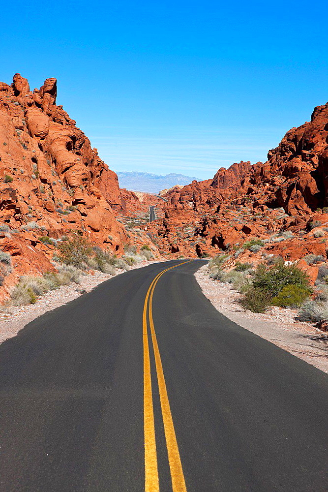 Valley of Fire Road with red sandstone formations in the background, Valley of Fire State Park, Nevada, United States of America.