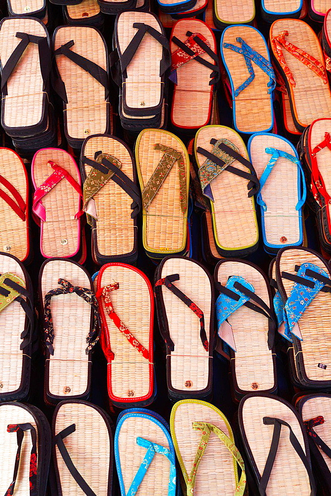 Sale of colorful Sandals on a Street Market in Luang Prabang, Laos