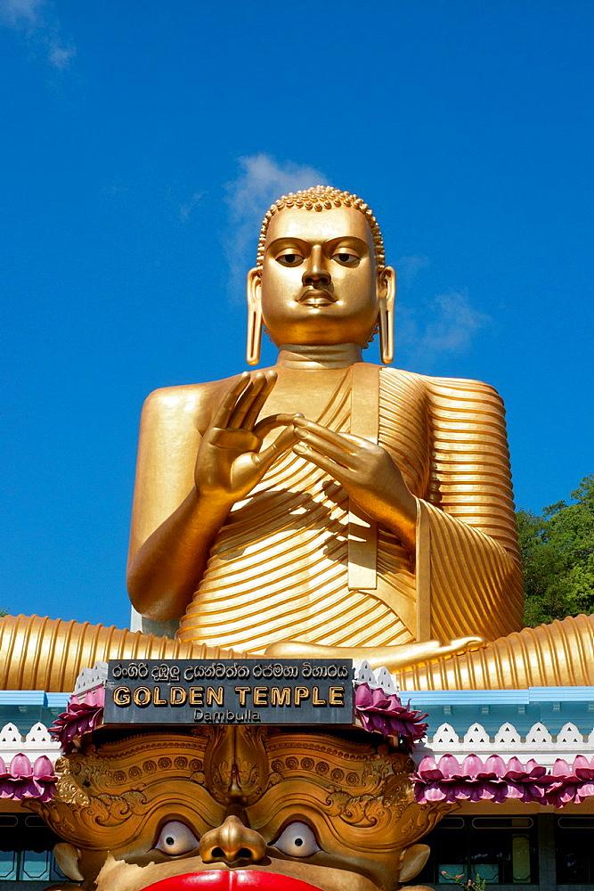 Golden Buddha outside the Dambulla Buddhist Cave Royal Rock Temple, Dambulla, Sri Lanka, Indian Ocean, Asia.