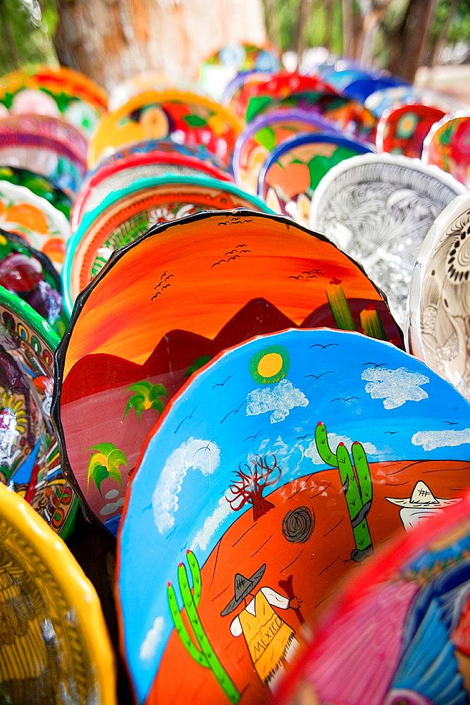 Colorful ceramic plates at an open market in Chichen Itza Ruins, Yucatan, Mexico.