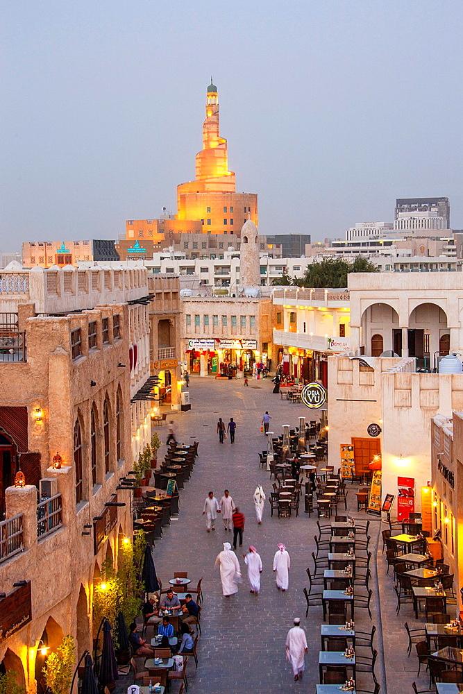 Qatar, Doha City, Souk Wakif and Islamic Culture Center at night.