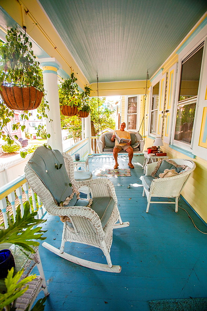 Rocking chairs and swing on a front porch, create a memory of a begone era in Cape May¥s historic district of Victorian style homes.