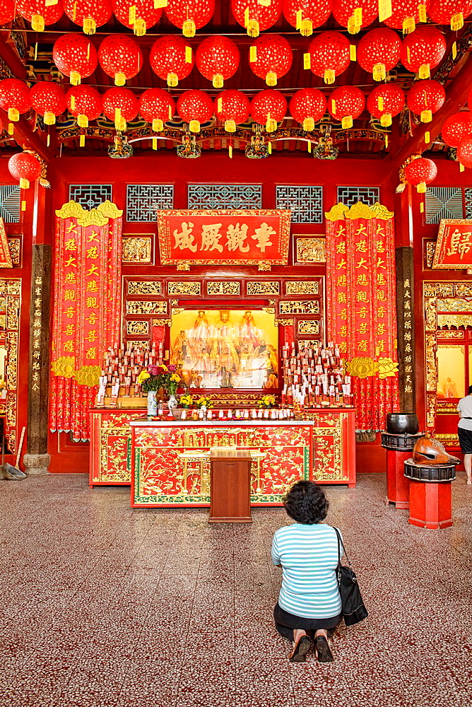 praying in Kong Hock Keong Shrine in Georgetown in Penang, Malaysia.