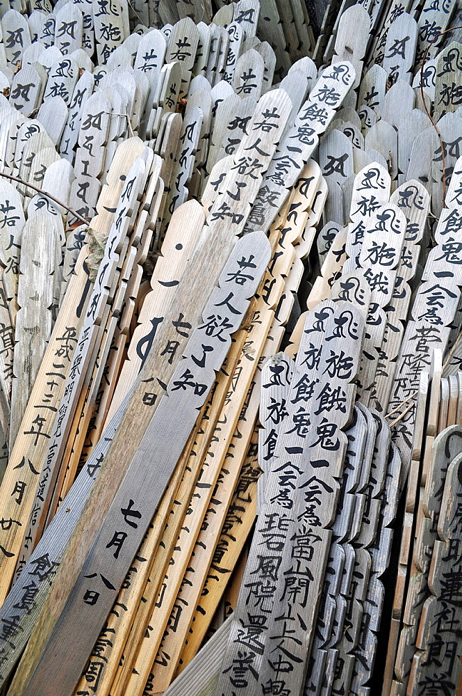 Kamakura, Kanagawa, Japan, funerary sticks at a cemetery